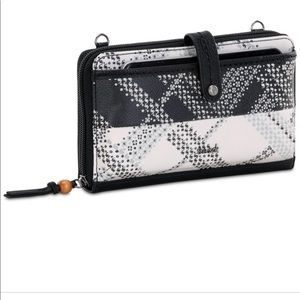 The Sak NWOT smartphone Wristlet crossbody bag
